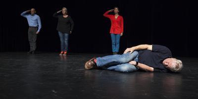 Dutchbatter Gerry Kremer uit Vries liggend op het toneel tijdens de repetities van Dark Numbers in theater Frascati in Amsterdam. Foto Casper Koster