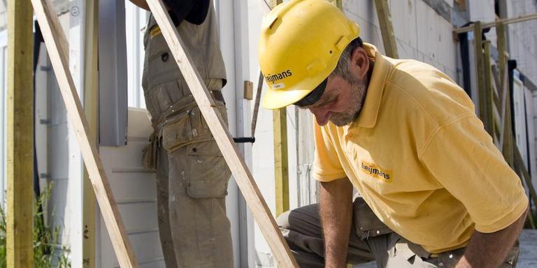 Werken in de bouw geldt als een zwaar beroep. Foto ANP