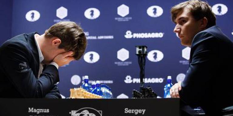 Vijfde partij Carlsen en Karjakin ook remise