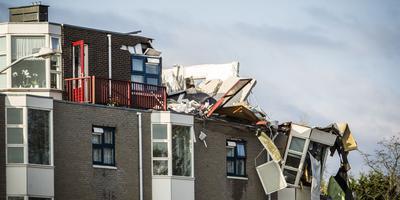 De radiator van een van de woningen hangt over de rand van de flat (Foto: ANP)