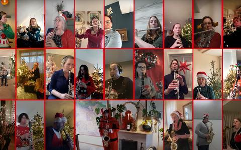 Een heel orkest dat thuis zit, maar via videoverbinding toch samen een lied maakt. Zo ziet dat eruit (met Kris en Ria in Gruno's Postharmonie)