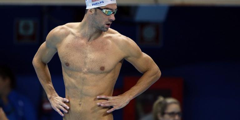 Phelps draagt Amerikaanse vlag in Rio