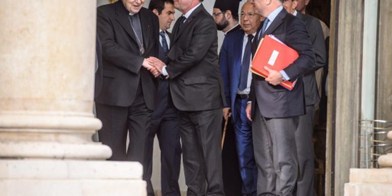 Hollande ontmoet kerkvertegenwoordigers