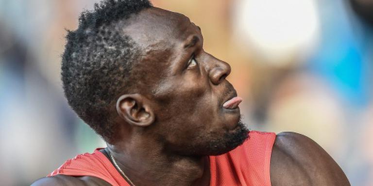 Klagende Bolt loopt tweede tijd in Kingston