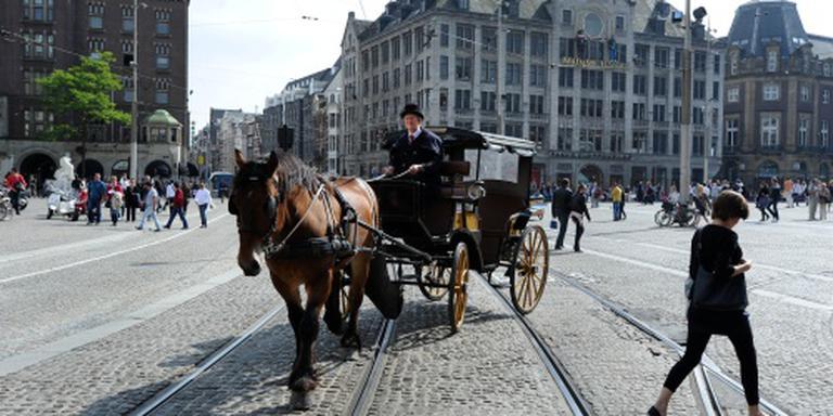 'Leg werk koetspaarden aan banden'