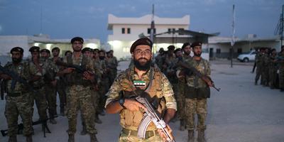 Militairen van het Nationale Syrische Leger staan te trappelen om de Koerden te verdrijven.