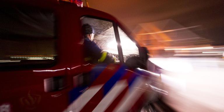 Woningen ontruimd door brand in flat Schiedam