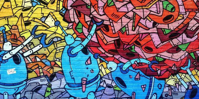 Een muur vol graffiti. FOTO PIXABAY