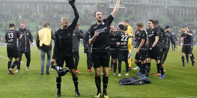 2018-12-16 16:23:18 GRONINGEN, 16-12-2018, Hitachi Capital Mobility Stadium, season 2018 / 2019, Dutch Eredivisie, FC Emmen player Michael Chacon and FC Emmen player Anco Jansen celebrating the 1-2 win during the match FC Groningen - FC Emmen.