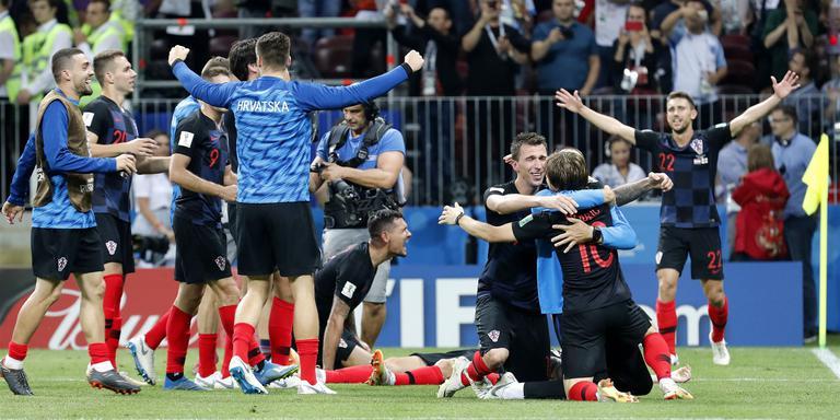 De spelers van Kroatië zijn uitzinnig van vreugde na de overwinning op Engeland. Foto: EPA